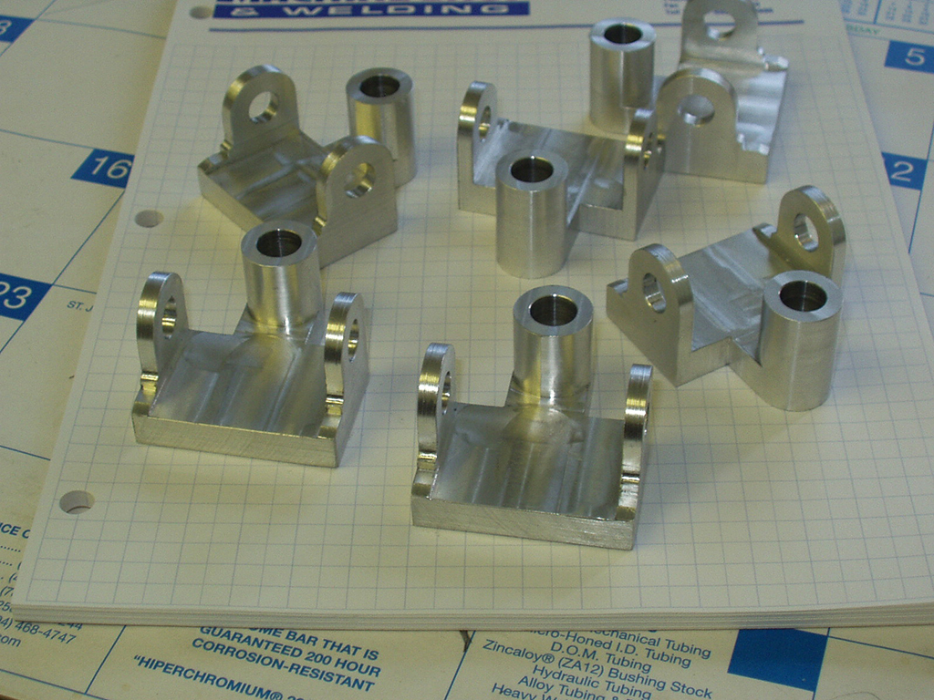 Aluminum pivot bosses for pulp mill
